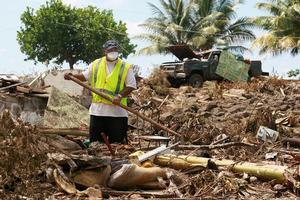 A volunteer earlier this month looking for bodies after the devastating tsunami in Samoa. Photo / Brett Phibbs