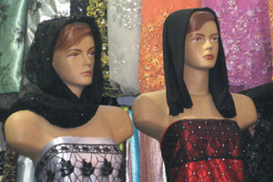 Mannequins clad in figure-hugging strapless gowns and black headwear on display in Shiraz bazaar. Photo / Jill Worrall