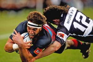 Canterbury's Sam Whitelock scores in the tackle of Richard Buckman last night. Photo / Getty Images