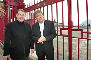 John Banks (L) and Mike Lee stand outside the Queens Wharf gates. Photo / Martin Sykes