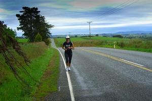Ultra-marathoner Lisa Tamati on a lonely Southland road, two days into her epic run up the length of New Zealand.