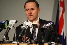 John Key announces the new system during yesterday's press conference. Photo / Mark Mitchell