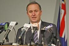 Prime Minister John Key announces the MPs' housing allowance cap this afternoon. Photo / Mark Mitchell