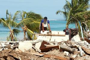 A villager stands amid the rubble at a tsunami-hit part of Samoa's southeastern coast. Photo / Brett Phibbs