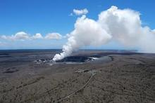 Halema'uma'u crater has a new vent with molten rock boiling up from the core of the planet. Photo / Jim Eagles