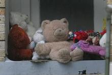 Toys outside the Rotorua house where Trent Matthews died. Photo / Alan Gibson