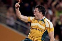 Adam Ashley-Cooper celebrates his decisive try for the Wallabies last night. Photo / Getty Images