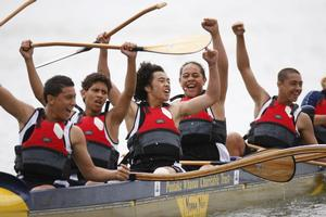 Avondale College's Waka Ama division two team celebrate their heat win at Orakei Basin, Auckland. Photo / Richard Robinson