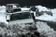 Cars stranded after heavy snow last weekend. Photo / Paul Taylor