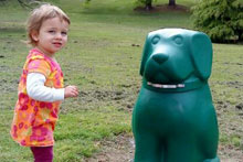 My daughter with the newly-installed dog poo receptacle. Photo / Dita De Boni