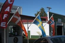 Scandinavian flags flying in Norsewood. Photo / Jill Worrall