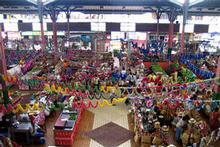 Papeete's market is open daily, selling a sizzling range of foods and exotic goods. Photo / Wikimedia Commons image from user FRED