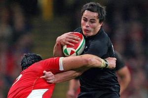 All Blacks wing Zac Guildford on attack during this morning's test against Wales in Cardiff. Photo / Getty Images