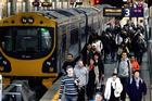 Passengers depart a train at Auckland's Britomart Station. Photo / Doug Sherring