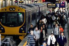 Passengers depart a train at Auckland's Britomart Station. Photo / Doug Sherring