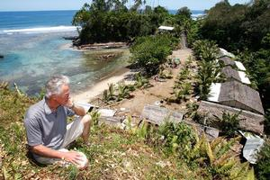 Bay of Plenty's Andy Belcher sits above the Seabreeze Resort that was devastated by the tsunami. Photo / Brett Phibbs