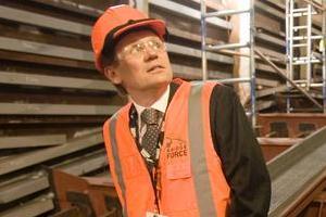 Transport Agency official Tommy Parker inside one of the harbour bridge clip-ons. Photo / Paul Estcourt