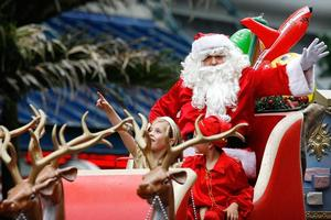 Santa waves to the thousands that turned out to the annual Farmers Santa Parade. Photo / Greg Bowker