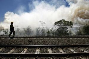 Firefighters had to douse four scrub fires near South Auckland railway lines yesterday. Photo / Steven McNicholl