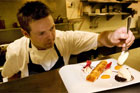 Head chef Ben Bayly puts the final touches on desserts at The Grove. Photo / Babiche Martens