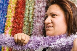 Marama Hetaraka with scarves to comfort abuse victims. Photo / Paul Estcourt