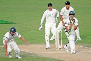 Salman Butt of Pakistan works the ball past Daniel Flynn of New Zealand during day three. Photo / Getty Images