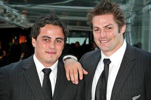 Zac Guildford (left) and Richie McCaw have good reason to take a celebratory drink at SkyCity last night. Photo / Greg Bowker