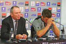 Graham Henry and Richie McCaw face the media after the All Blacks' shocking defeat to France at the 2007 World Cup. Photo / Getty images