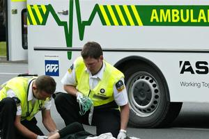 An ambulance crew attend to an injured pedestrian in Whangarei. File photo / Northern Advocate