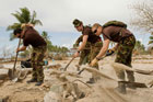 NZ Army personnel help out with tsunami clean-up operations on the island of Tonga back in October. Photo supplied.