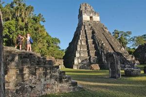 Tourists explore the Mayan ruins at Tikal. Photo / Supplied