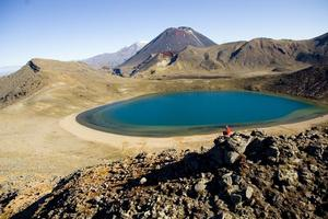 The Tongariro Crossing track descends steeply down loose scree to the eye-catching Emerald Lakes. Photo / Destination Taupo