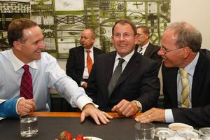 Prime Minister John Key chats with Super City mayoral contenders John Banks and Len Brown. Photo / Kenny Rodger