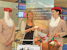 Emirates cabin crew members Lisa Beer (L) of New Zealand and Angela Harding had free chocolates for passengers on the first A380 service to Auckland today.
