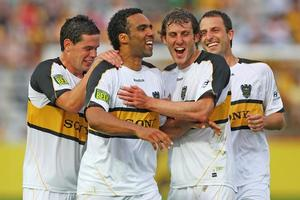 Paul Ifill of the Phoenix celebrates with team mates after scoring a goal. Photo / Getty Images