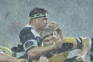 All Black prop Craig Dowd has a firm grip on his Taranaki opposite as the rain buckets down at Eden Park. Photo / Kenny Rodger