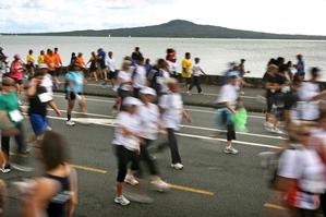 Runners, walkers and children along for the ride turned out for the 8km Round the Bays race and fun run. Photo / Natalie Slade