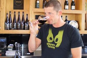 Spy Valley winemaker Paul Bourgeois with the 2007 pinot noir judged best red wine in business class. Photo / Supplied