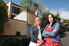 Sisters Lisa (left) and Michelle Turner have fought a major battle to win compensation for their leaky Mairangi Bay townhouse. Photo / Brett Phibbs 