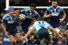 Jerome Kaino, with mates in support, pushes off Francois Hougaard of the Bulls. Photo / Getty Images