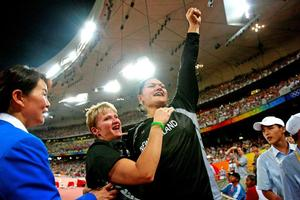 Valerie Vili and coach Kirsten Hellier share Vili's moment of victory at the Beijing Olympics. Photo / Kenny Rodger