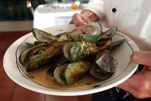 Fragrant: Chilli coconut mussels from Porcini. Photo / Dean Purcell
