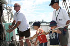 The boys helped the crew during the harbour sail on the Ted Ashby. Photo / Alex Eagles