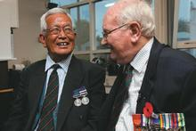 John Masters, 75, (right) laughs with Hariprasad Gurung, 76, during a reunion at Christchurch's Papanui RSA. Photo / Simon Baker
