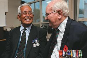John Masters, 75, (right) laughs with Hariprasad Gurung, 76, during a reunion at Christchurch's Papanui RSA. Photo / Simon Baker