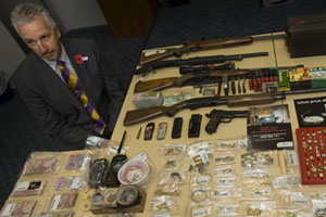 Detective Inspector Greg Cramer with part of the haul of stolen goods recovered from second-hand dealers in the Auckland region. Photo / Paul Estcourt