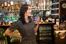 Auckland bar manager Nicola Reid, 20, thinks reform would be helpful to stop younger customers misbehaving. Photo / Richard Robinson 