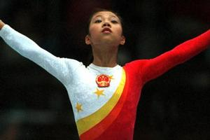 Fangxiao Dong competing at the women's teams final at the 1999 Tianjin World Gymnastics Championships in China. Photo / Jack Atley / ALLSPORT