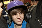 Fans scream for teen singing sensation as he arrives at Auckland Airport.