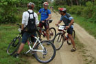 Cyclists take a break during Niue's Rally of the Rock. Photo / Paul Johnson